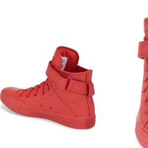 All red women's Chuck Taylors/ converse hi-tops